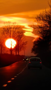 Red sunset on the road