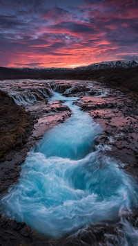 Sunset-at-the-waterfall-Brúarfoss